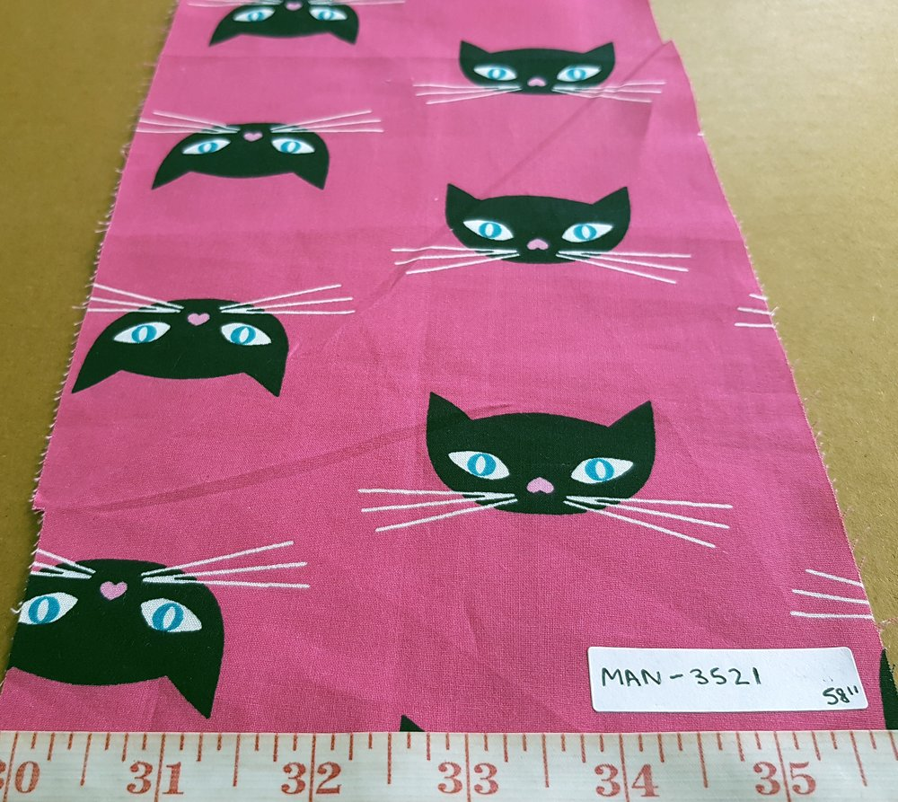 cotton print fabric in pink and black color with cats printed on pink base cotton