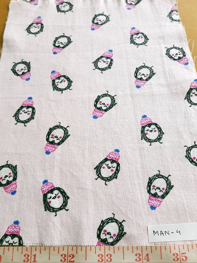 Cotton print fabric in penguin print, on a soft pastel base