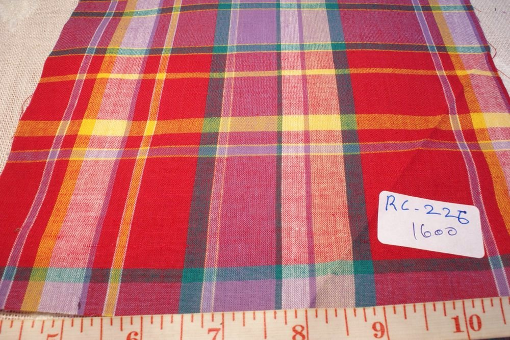 madras fabric in red, fuschia, yellow, green and lavender plaids