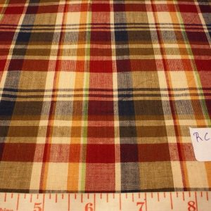 madras fabric in fawn, rust red, yellow, green and blue plaid