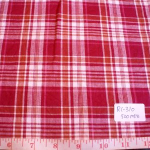 Madras plaid fabric in red, orange and white plaids