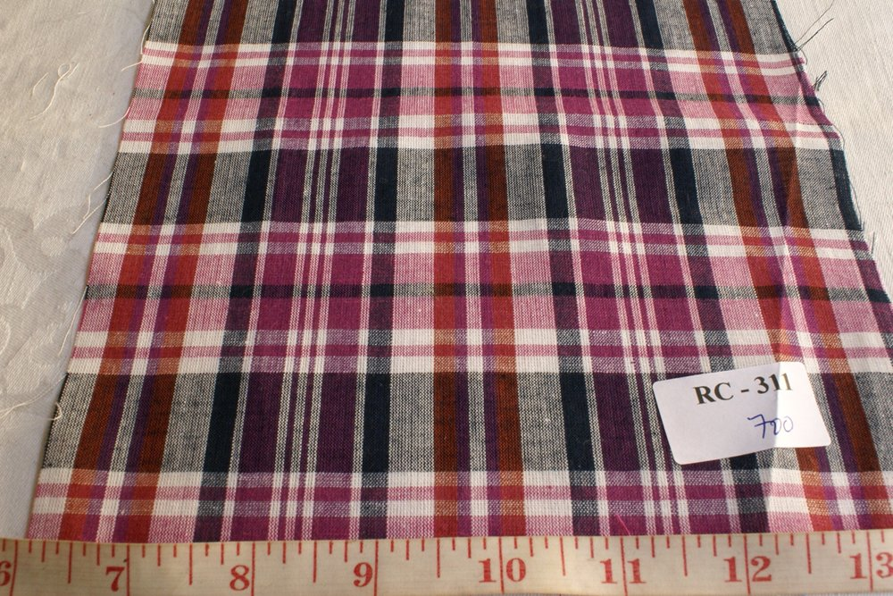 Madras fabric in Purple, black, rust and white color plaids