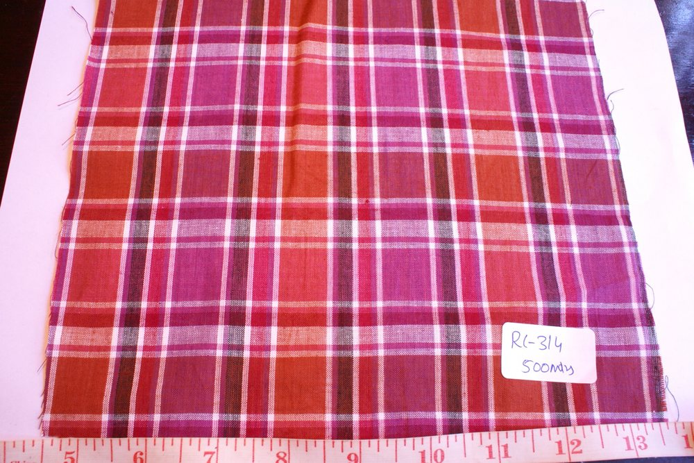 Madras fabric in fuschia, red, brown and white plaid