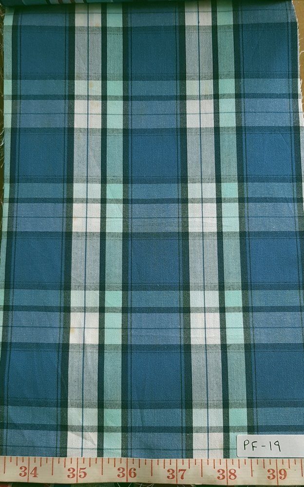 Madras Plaid Fabric made of cotton yarns woven in a plaid pattern, for men's jackets, neckwear, shirts, children's and pet clothing. Also known as checks.
