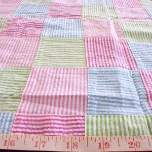 Seersucker fabric in patchwork, with seersucker stripes for preppy summer seersucker shirts, coats, ties, bowties and ivy league style menswear.