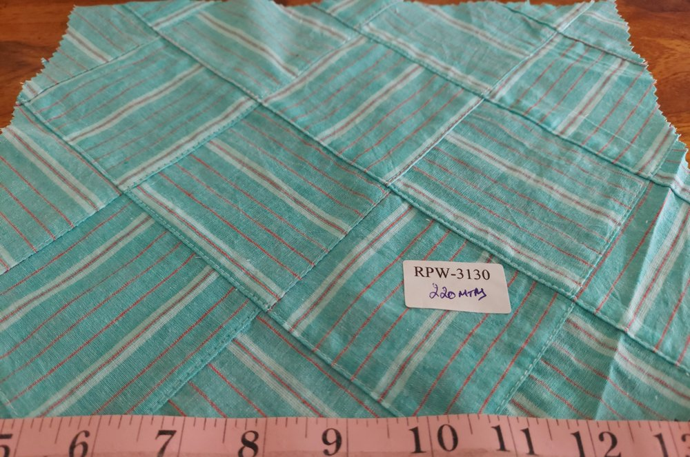 Patchwork Stripe fabric made of diagonal stripe fabrics of various colors, used for preppy menswear & classic children's clothing.