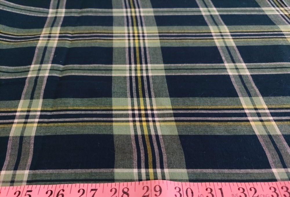 Plaid Fabric or madras cloth, made of cotton, used for plaid shirts, vintage menswear, plaid ties and bowties and classic children's clothing.