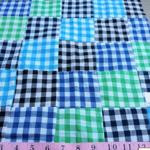 Gingham Patchwork fabric made of gingham squares sewn together into a patchwork fabric for shirts, boy's clothing and menswear.