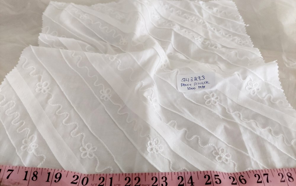 Embroidered Fabric made with thread embroidery on a base fabric, used for vintage clothing, heirloom clothing & bridal dresses.